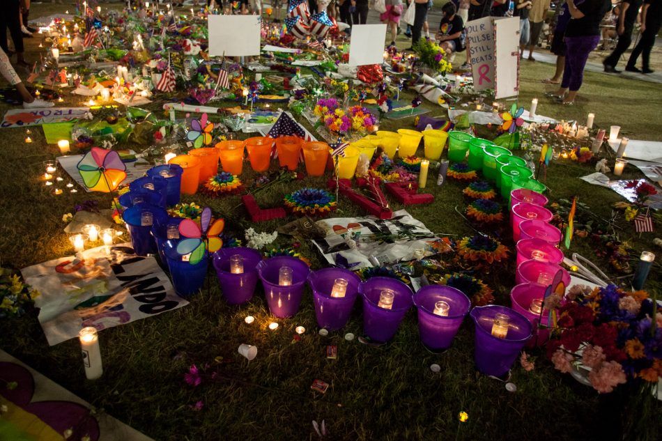 A continuous stream of flowers, candles, and signs cover the lawn of the Dr. Phillips Center for the Performing Arts in Orlando, Fl on June 19, 2016.
